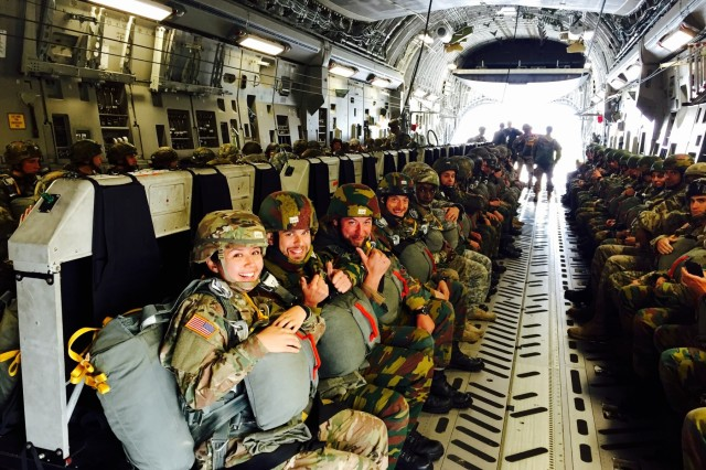 Paratroopers from the 173rd Airborne Brigade, 82nd Airborne Division and Belgian army get ready to conduct an airborne operation together during Operation Market Garden in the Netherlands, Sept. 19, 2015.