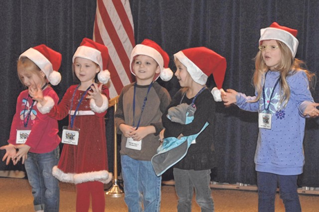 Students from the Child Development Center Bright Beginnings Pre-K perform at the St. Nick's Benefit Ceremony Dec. 8 at Grant Hall Auditorium.