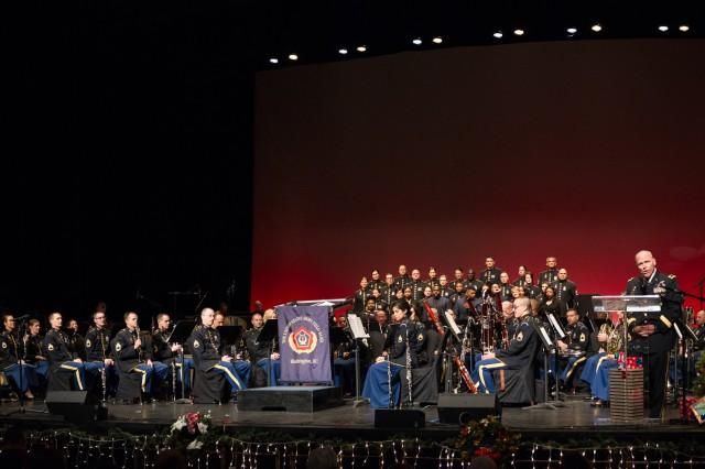 "Brig. Gen. Frank Muth, director of the Army Quadrennial Defense Review Office, introduces the 141-member Army Field Band at the Hippodrome Theatre in Baltimore, Dec. 6, 2015. Muth, a Baltimore native, introduced the band as part of the ""Meet Your Army"" campaign initiative."