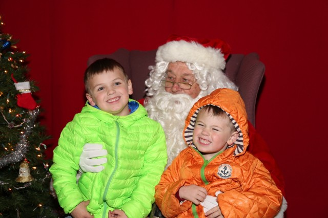 Youth community members took pictures with Santa Claus at the annual holiday concert and Christmas tree lighting ceremony held Dec. 1, on the installation. (U.S. Army photo by Lance Davis)