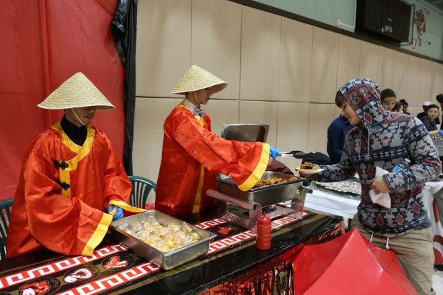 """Several community members tastes cuisine from """"around the world"""" at the annual Christmas Around the World event held Dec. 4, at the Camp Zama Youth Center. (U.S. Army photo by Lance Davis)"""