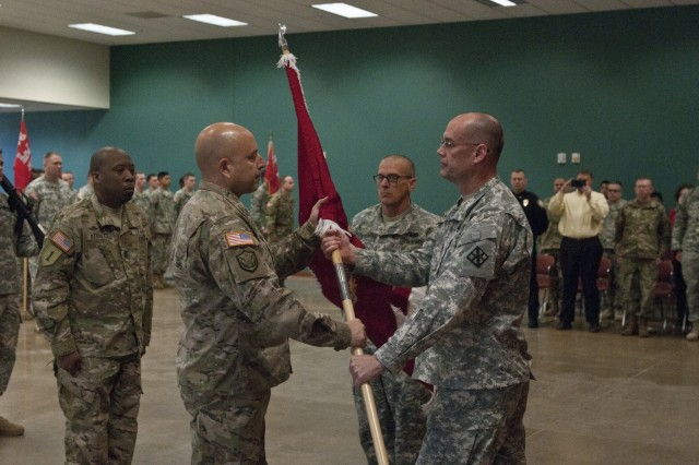 U.S. Army Reserve Col. Ralph Henning (right), commander, 411th Engineer Brigade, passes the guidon to Lt. Col Joseph Amon, commander, 363rd Engineer Battalion signifying Amon acceptance command of the 363rd. The 363rd Eng. Bn. was activated in a ceremony Dec. 5 in Knightdale, N.C. (U.S. Army photo by Staff Sgt. Debralee Best)
