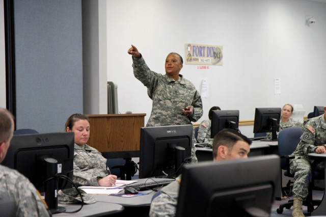 An instructor, assigned to the 4th Brigade, 94th Division's Army Basic Instructor Course on Fort Dix, N.J., presents her class with a course overview.  During the 10-day course, students will learn critical communication skills and the fundamentals of teaching to become certified army instructors.