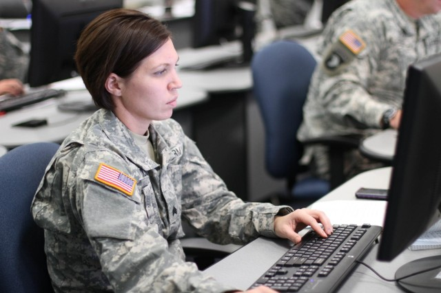 Sgt. Marcy DiOssi, assigned to the 1/95th Engineer Battalion out of Fort Leonard Wood, Mo., works on her class presentation during the Army Basic Instructor Course on Fort Dix, N.J.