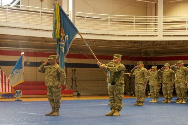 Lt. Col. AJ Covert (far left), commander of the 303rd Military Intelligence Battalion, salutes with his battalion as the national anthem is played during the unit's deployment ceremony, Sept. 25. The battalion deployed to Afghanistan to provide multi-dimensional intelligence to battlefield and theater commanders.