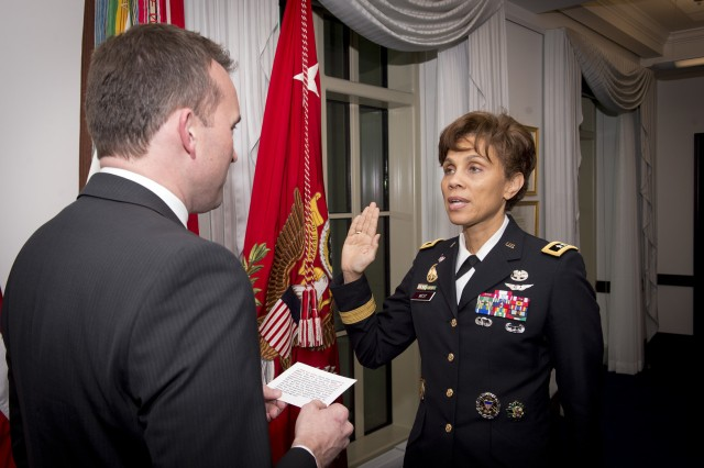 Acting Army Secretary Eric Fanning swears in Maj. Gen. Nadja West as the 44th surgeon general of the Army and commanding general of U.S. Army Medical Command, Dec. 11, 2015.