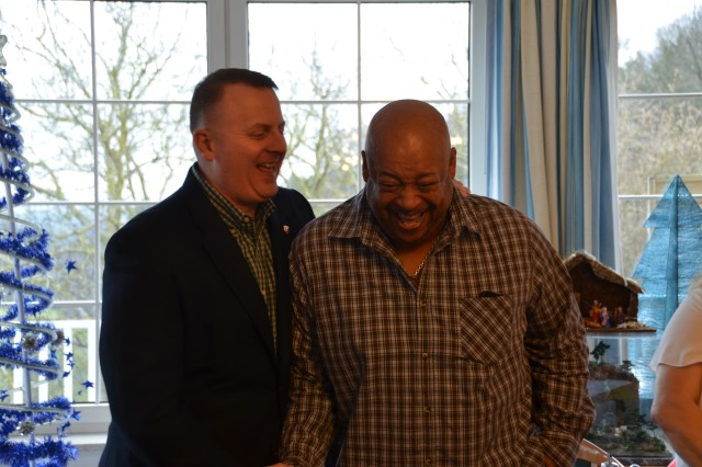 ANSBACH, Germany (Dec. 15, 2015) -- Col. Todd S. Bertulis, left, commander of the 405th Army Field Support Brigade, congratulates Ray Yarbrough for outstanding customer service at the Central Issue Facility. Members of the Logistics Readiness Center - Ansbach assembled at a local golf club Dec. 2 to recognize their workforce for capably handling a large throughput during a time of short staffing. (U.S. Army photo by Bryan Gatchell, USAG Ansbach Public Affairs)