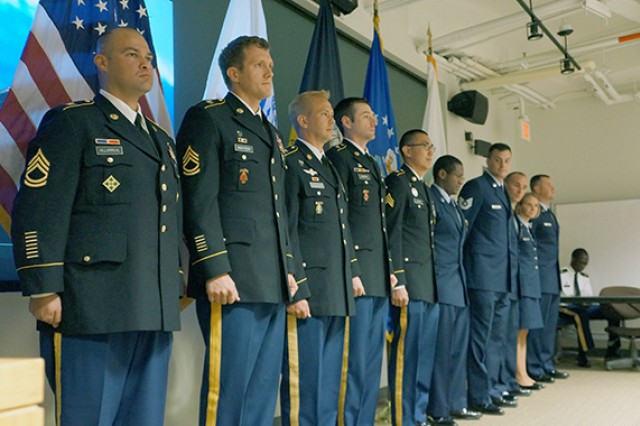 Students in the Uniformed Services University of the Health Sciences' Enlisted to Medical Degree Preparatory Program stand at attention while being recognized for their academic achievements at George Mason University during the program's inaugural year. From left, the Soldiers are, Sgt. 1st Class Jesus Villarreal, Sgt. 1st Class Joshua Richter, Sgt. 1st Class Steven Radloff, Staff Sgt. Claude Blereau and Sgt. Steven Capen.