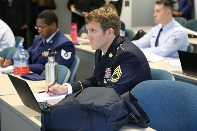 Sgt. 1st Class Joshua Richter takes notes during one of his Enlisted to Medical Degree Preparatory Program classes at George Mason University in Manassas, Va.