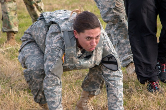 "Pvt. Michelle Strang, a supply specialist with HHC, 1st ABCT, 1st Cav. Div., pushes herself through the 100 m ""burpee"" broad jump during the Iron Hammer Challenge Dec. 10 at Fort Hood, Texas. (U.S. Army photo by Sgt. Christopher Dennis, 1st Armored Brigade Combat Team Public Affairs, 1st Cav. Div.)"