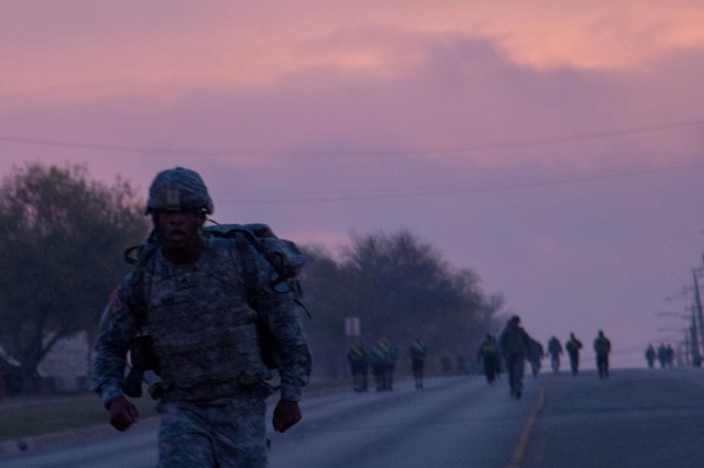 Sgt. Justyn Duke, a geospatial engineer with Headquarters and Headquarters Company, 1st Armored Brigade Combat Team, 1st Cavalry Division, finishes first in the 3.5-mile ruck march during the Iron Hammer Challenge Dec. 10 at Fort Hood, Texas. (U.S. Army photo by Sgt. Christopher Dennis, 1st Armored Brigade Combat Team Public Affairs, 1st Cav. Div.)