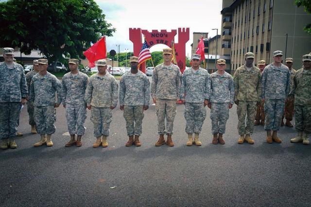 The 3rd Squad, 2nd Platoon, 523rd Horizontal Engineer Company, 84th Engineer Battalion, 130th Engineer Brigade, 8th Theater Sustainment Command, stands during a ceremony after winning the 84th Engineer Brigade Best Squad Competition at Schofield Barracks, Hawaii, on Oct. 16, 2015.