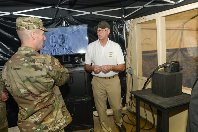 Sgt. Maj. of the Army Daniel A. Dailey sees a demonstration of U.S. Army Communications-Electronics Research, Development and Engineering Center's Night Vision and Electronic Sensors Directorate's degraded visual environment-mitigation capability on Fort Belvoir, Va., Dec. 14, 2015.
