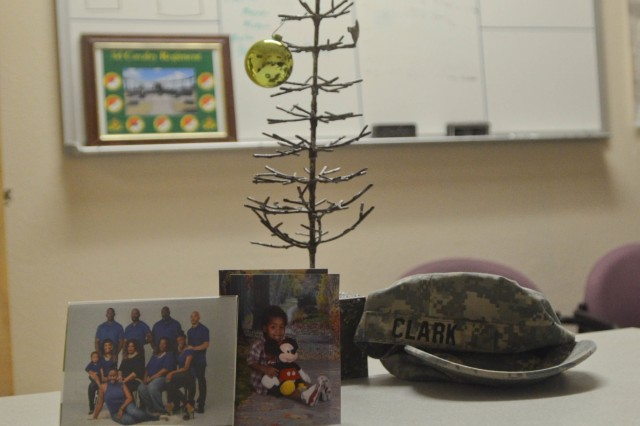 The scantly decorated Christmas tree that sits atop my desk before the holidays at the 3rd Cavalry Regiment headquarters building Dec. 15. (Photo by Staff Sgt. Tomora Clark 3rd Cavalry Regiment Public Affairs NCOIC)