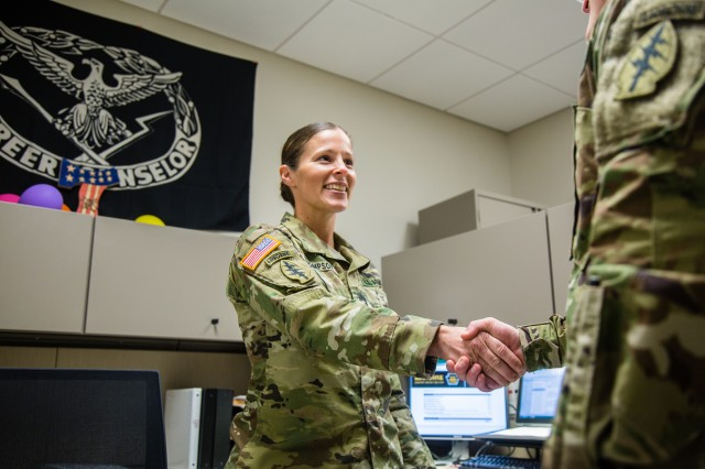 Sgt. 1st Class Jill Thompson, left, greets a Soldier in her office in 7th Special Forces Group (Airborne)'s Group Support Battalion. Thompson was recently recognized as the in the 1st Special Forces Command (Airborne) (Provisional)'s Career Counselor of the Year.