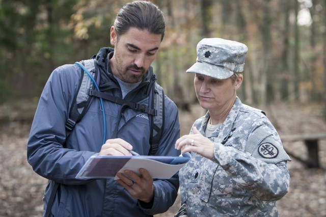 At a Fort Campbell, Ky., training area, Ben Sheffield, a research audiologist from Army Public Health Center (Provisional), and Lt. Col. Amy Blank, an audiologist from Walter Reed National Military Medical Center, study the effects of hearing loss on Soldier performance.