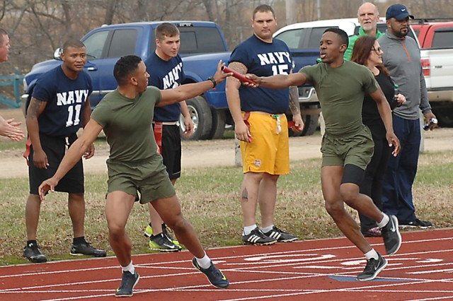 Marine Corps runner Baron Barber hands the baton to teammate Michael Tillman during the annual All Service 4-by-400 Relay on Saturday at Gerlach Field. Barber, Tillman and teammates Travis Holmes and Dayshawn Franklin won the event, setting a new post record with a time of 3:43.
