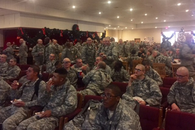 Fort Leonard Wood Soldiers in training enjoy at snack and a movie among the holiday decorations at the USO Sunday.