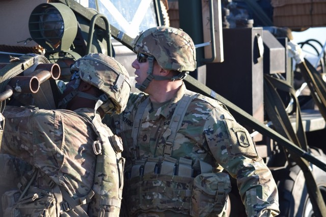 SFC Seth Henderson of B Co, 54th Brigade Engineer Battalion (Airborne), derigs a SEE truck on Hohenfels DZ with another B Co Soldier.