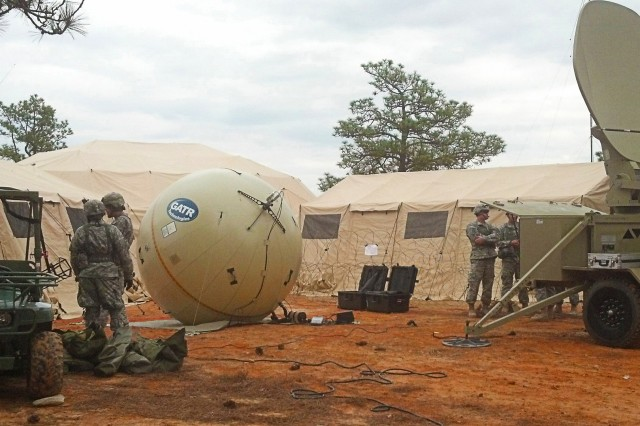 Because the T2C2 solution is inflatable, it can provide a larger dish size with increased capability and bandwidth efficiency in a smaller package.   The Army will use two sizes of the inflatable satellite antenna for the Low Rate Initial Production of Transportable Tactical Command Communications (T2C2) Lite (v1) and T2C2 Heavy (v2).  (U.S. Army photo)