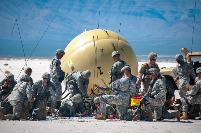 The Army will use two sizes of the inflatable satellite antenna for the Low Rate Initial Production of Transportable Tactical Command Communications (T2C2) Lite (v1) and T2C2 Heavy (v2). During Joint Forcible Entry operations at Network Integration Evaluation 16.1 in October 2015, the 82nd Airborne Division successfully utilized the capability to provide early entry network communications during the mission. (photo credit: Jett Loe,Sun-News)