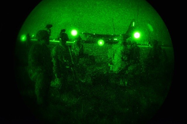 U.S. Army paratroopers assigned to the 2nd Battalion, 503rd Infantry Regiment, 173rd Airborne Brigade, prepare a follow-on mission after exiting a U.S. Air Force 86th Air Wing C-130 Hercules during Exercise Rock Nemesis at Rivolto Air Base, Italy, Dec. 4, 2015. The 173rd Airborne Brigade is the U.S. Army Contingency Response Force in Europe, capable of projecting ready forces anywhere in the U.S. European, Africa or Central Commands areas of responsibility within 18 hours. (U.S. Army Photos by Visual Information Specialist Paolo Bovo/Released)