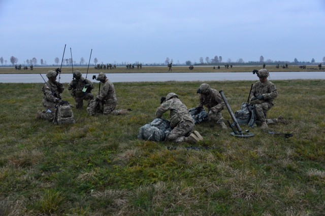 U.S. Army paratroopers assigned to the 2nd Battalion, 503rd Infantry Regiment, 173rd Airborne Brigade, conduct a radio check during Exercise Rock Nemesis at Rivolto Air Base, Italy, Dec. 4, 2015. The 173rd Airborne Brigade is the U.S. Army Contingency Response Force in Europe, capable of projecting ready forces anywhere in the U.S. European, Africa or Central Commands areas of responsibility within 18 hours. (U.S. Army Photos by Visual Information Specialist Paolo Bovo/Released)