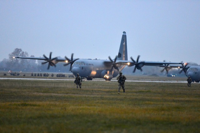U.S. Army paratroopers assigned to the 2nd Battalion, 503rd Infantry Regiment, 173rd Airborne Brigade, conduct a follow-on mission after exiting a U.S. Air Force 86th Air Wing C-130 Hercules during Exercise Rock Nemesis at Rivolto Air Base, Italy, Dec. 4, 2015. The 173rd Airborne Brigade is the U.S. Army Contingency Response Force in Europe, capable of projecting ready forces anywhere in the U.S. European, Africa or Central Commands areas of responsibility within 18 hours. (U.S. Army Photos by Visual Information Specialist Paolo Bovo/Released)