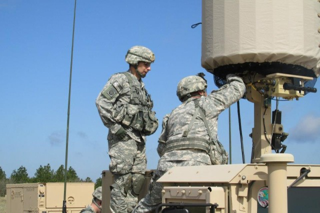 Soldiers in the field level the Lightweight Counter Mortar Radar system. The radar provides 3-D, 360-degree warning capability against incoming artillery and mortar fire.