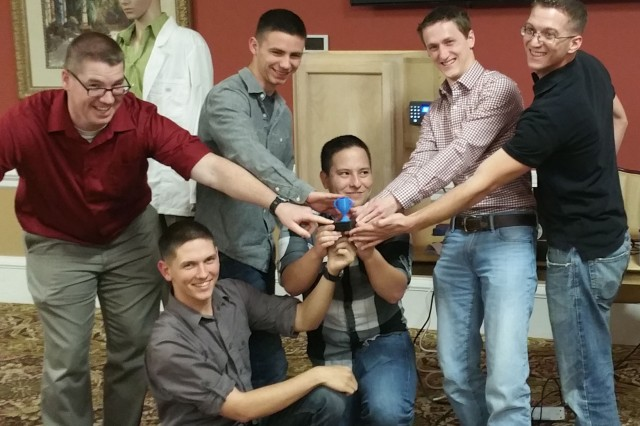 The winning team from Charlie Company show off the 3-D-printed Hack-A-Thon trophy, left to right: Sgt 1st Class Ian Sabin, Pfc. Steven McMaster, Spc. Ethan Auge, Chris Tucker, Kevin Ebersole and Sgt. Daniel Forsberg.