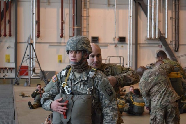 Chief Warrant Officer 2 Tony Owens of the 5th Quartermaster Theater Aerial Delivery Company performs a jumpmaster personnel inspection on a paratrooper during Toy Drop 2015. (U.S. Army photo by Chief Warrant Officer 2 Jonathon Crane, 5th Quartermaster Theater Aerial Delivery Company)