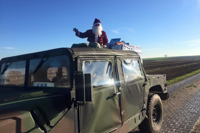 Santa arrives with his toys after safely jumping onto Alzey drop zone. (U.S. Army photo by Spc. Crystal Torresz, 5th Quartermaster Theater Aerial Delivery Company)