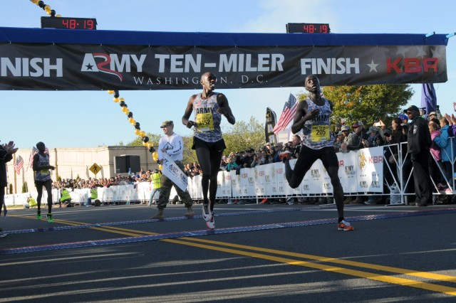 Soldiers and teammates Paul Chelimo and Nicholas Kipruto finish the Army Ten-Miler at 48:19 with Chelimo winning by seconds. Their teammate and fellow Soldier, Shadrack Kipchirchir took third, Oct. 11, 2015, near the Pentagon in Arlington, Va.