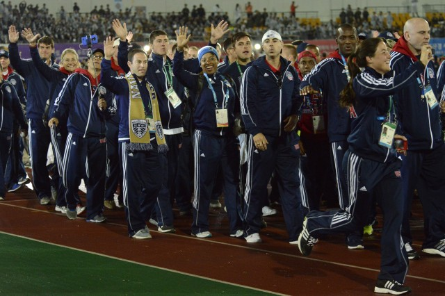 U.S. Armed Forces athletes wave to the crowd as they walk into the closing ceremony of the Conseil International du Sport Militaire World Games in the main stadium of the Korean Armed Forces Athletic Corps in MunGyeong, South Korea, Oct. 11, 2015.