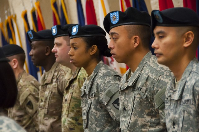 U.S. Army Sustainment Command Soldiers stand at parade rest during the Headquarters and Headquarters Company change of command ceremony in Heritage Hall, Rock Island Arsenal, Illinois, Dec 21. (Photo by Kevin Fleming, ASC Public Affairs)