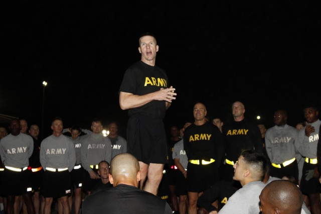 Sgt. Maj. of the Army Daniel A. Dailey speaks with U.S. Army Central Soldiers after joining them on an esprit de corps run on Camp Arifjan, Kuwait, Dec. 18, 2015.
