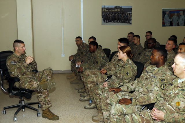 Sgt. Maj. of the Army Daniel A. Dailey speaks with junior noncommissioned officers from U.S. Army Central during a town hall on Camp Arifjan, Kuwait, Dec. 18, 2015.