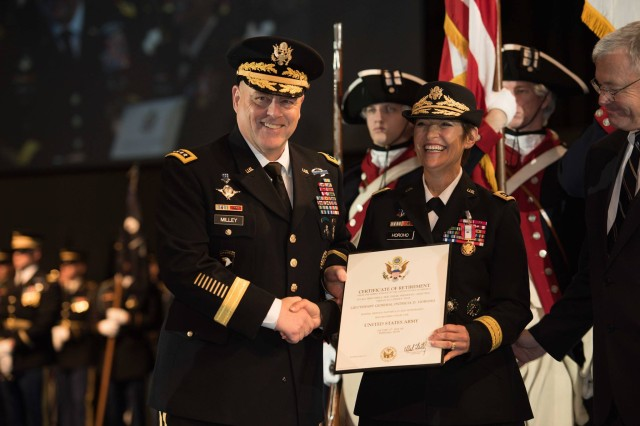 Army Chief of Staff Gen. Mark A. Milley awards a Distinguished Service Medal to Army Surgeon General Lt. Gen. Patricia D. Horoho during a retirement ceremony at Conmy Hall on Joint Base Myer-Henderson Hall, Va., Dec. 15, 2015. To her right is her husband, Ray.