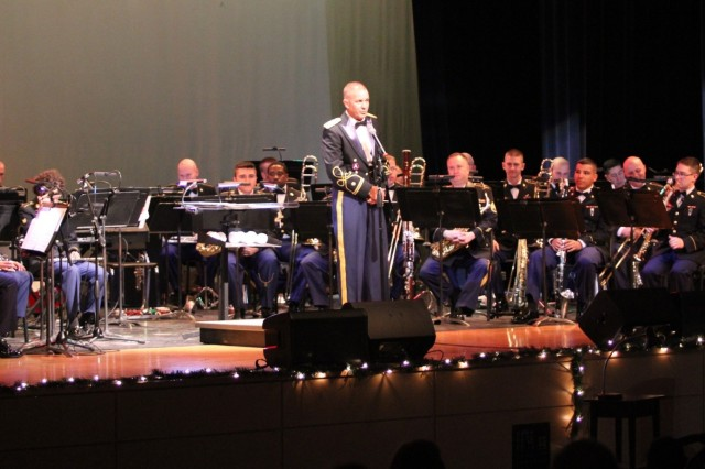 "The 1st Cavalry Division Band performs during ""A Hill Country Holiday"" concert Dec. 17 at the Harker Heights High School auditorium in Harker Heights, Texas. The band played hit songs by CeeLo Green, Garth Brooks, Dizzy Gillespie and a holiday classic by Leroy Anderson as more than 100 attendees listened and sung along. (U.S. Army photo by Staff Sgt. Christopher Calvert, 1st Cavalry Division PAO (Released))"
