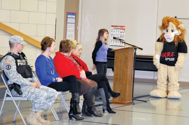 Crystal Adams, daughter of Seana Benvenuti and Sgt. Steven Berg, 1st Armored Brigade Combat Team, 1st Infantry Division, on Fort Riley, Kan., reads her essay she wrote her final D.A.R.E. project during the graduation ceremony at Ware Elementary.