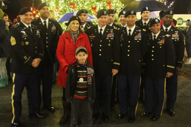 University Place Mayor Denise McCluskey is joined by Col. William A. Ryan, III, 16th Combat Aviation Brigade commander and leaders from throughout the brigade at Winter Fest 2015 in University Place, Wash., Dec. 5, 2015. University Place and 16th CAB are partners under 7th Infantry Division's Community Connector Program.