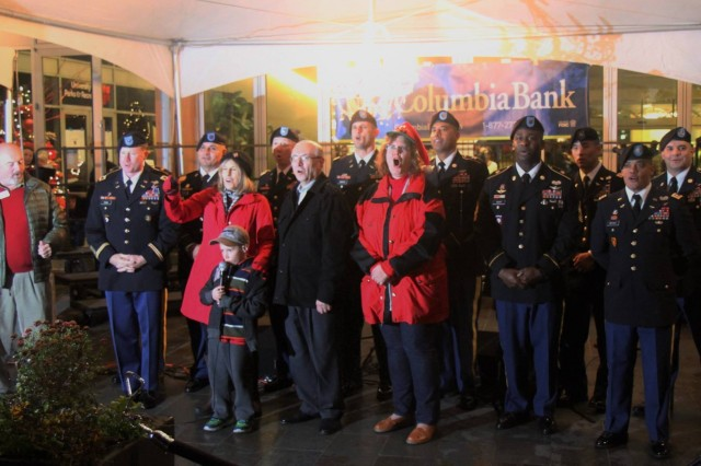 University Place Mayor Denise McCluskey is joined by Col. William A. Ryan, III, 16th Combat Aviation Brigade commander, and leaders from throughout the brigade as the tree is lit at Winter Fest 2015 in University Place, Wash., Dec. 5, 2015. University Place and 16th CAB are partners under 7th Infantry Division's Community Connector Program.