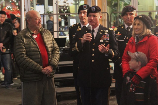 Col. William A. Ryan, III, 16th Combat Aviation Brigade commander, addresses the community at Winter Fest 2015 in University Place, Wash., Dec. 5, 2015. University Place and 16th CAB are partners under 7th Infantry Division's Community Connector Program.