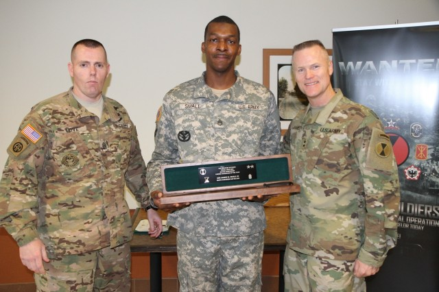 Staff Sgt. James Small, 864th Engineer Battalion, was honored as 7th Infantry Division Career Counselor of the Year, his award presented by Maj. Gen. Thomas James and Command Sgt. Maj. Jack Love.