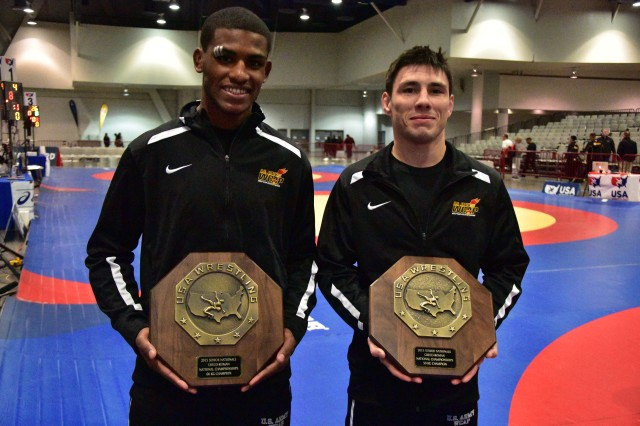 U.S. Army World Class Athlete Spc. Ildar Hafizov, left, bested teammate Sgt. Spenser Mango in the Greco-Roman 59 kg/130 lbs. weight class, securing his first-place trophy and advancing him to the Olympic trials during the U.S. Senior Nationals/Trials Qualifier in Las Vegas, Dec. 18-19, 2015.