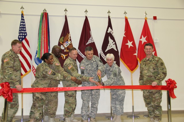 Fort Greely residents celebrated the official opening of the Fort Greely Army Medical Home during a ribbon cutting ceremony in front of a standing room only crowd, Dec. 15, 2015.