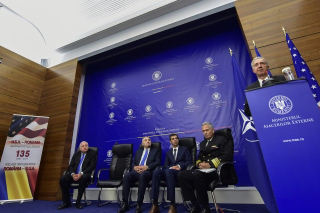 U.S. Ambassador to Romania Hans Klemm, speaks during a ceremony in Bucharest, Romania, announcing that all major military components of the Aegis Ashore Phase II facility at Deveselu are complete and have been handed over to the operational commander for future integration into NATO's ballistic missile defense architecture, Dec. 18, 2015.
