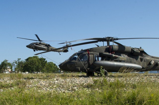 A U.S. Army UH-60 Black Hawk completes its final leg of the first day of a two-day troop movement, Dec. 16, 2015, in the Gracias a Dios Department (state) of Honduras.