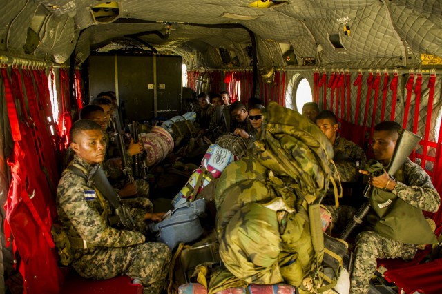 Honduran soldiers sit in the back of a U.S. Army CH-47 Chinook, Dec. 16, 2015, before transiting to a remote area in the Gracias a Dios Department (state) of Honduras.