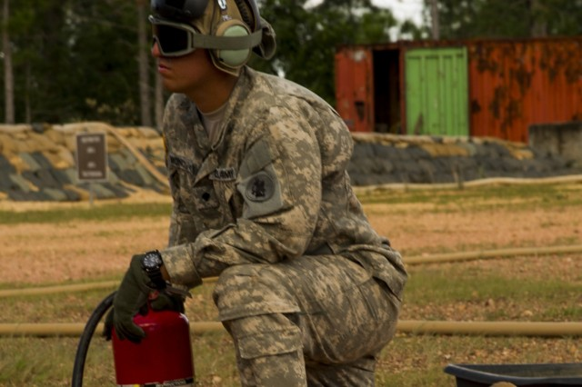 U.S. Army Cpl. Randy Moncivaiz, Joint Task Force-Bravo petroleum, oil and lubricant team leader, provides a safety over watch while a U.S. Army CH-47 Chinook is refueled at Mocoron Airfield in the Gracias a Dios Department (state) of Honduras, Dec. 17, 2015.